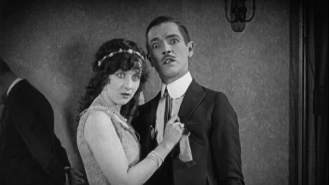 1925_monster_012_gertrude_olmstead_johnny_arthur